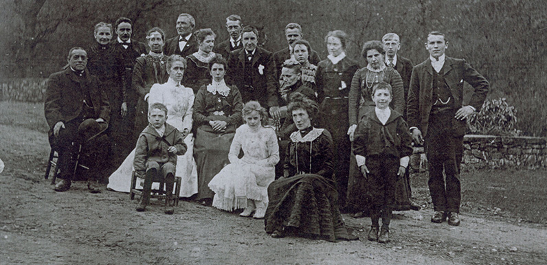 Servants and staff pictured on the drive, outside Errwood Hall.