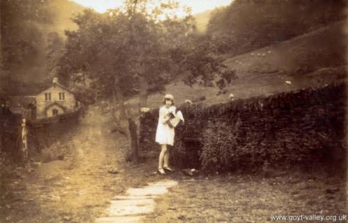 Kathleen Nash at Castedge spring. c.1920.